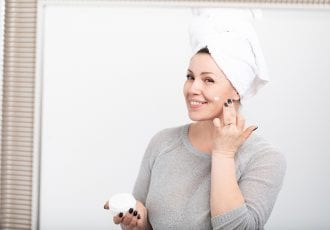 Woman middle age retinol cream